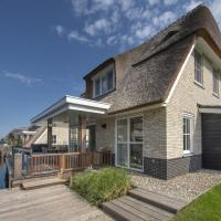 Beautiful, chic villa with a fireplace at the Tjeukemeer