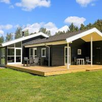 Three-Bedroom Holiday home in Strandby 4