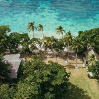 Whispering Palms - Absolute Beachfront Villas, hotel in Port Vila