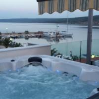 Luxury apartment by the sea with private whirlpool and terrace 50m2