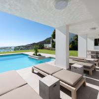 Sandpiper House: Stunning Ocean Views, Heated Pool & Large Garden