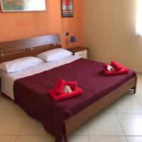 Attico Rosa, отель в городе Джоя-Тауро