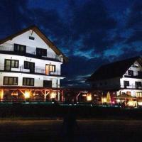 Pensiunea Alpina Casi & Spa, hotel din Păltiniş