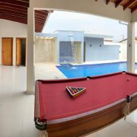 Casa com piscina aquecida e sauna integrada, em frente ao Aeroporto Internacional