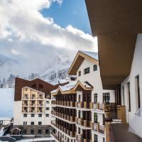 Rosa Ski Inn Hotel Rosa Khutor, hotel in Estosadok