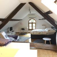 Ferienwohnung auf denkmalgeschütztem Sturmhof, hotel in Grefrath