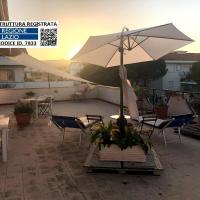 Attico Terra-Mare : Maxi Terrace - BBQ - WiFi, hotel in Santa Marinella