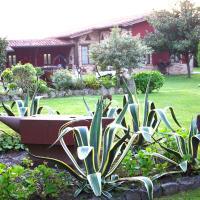 Espectacular casa rural con piscina y amplio jardín, hotel in Galizano