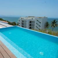 1 minute walk to the beach! Pool overlooking ocean. Condo Parotas