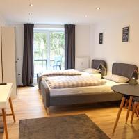 Moderne 1-Zimmer Wohnung mit Terasse, Küche, Bad mit Dusche, TV & WIFI, Hotel in Burgwedel