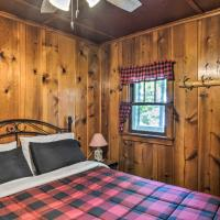 Cozy Carp Lake Cottage with Dock, 4 Kayaks and Fire Pit, hotel in Carp Lake