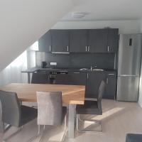 50 Quadratmeter abgeschlossene Wohnung mit Panoramablick, отель в городе Пфаффенхофен-ан-дер-Ильм