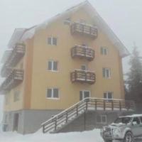Cabana Roua Munților, hotel in Vartop