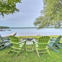 Waterfront Paradise Lake Cottage with Pvt Dock!, hotel in Carp Lake