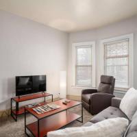 Clean, cozy Elmwood Village apartment with porch