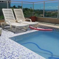 Lindo quarto e sala vista mar e piscina
