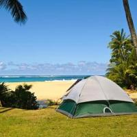 Private campsite with full self guided camping gear set, mobile unlimited wifi hotspot, security, free parking., hotel in Kahuku