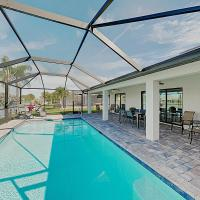 Impeccable Canal-Front Home w/ Lanai & Caged Pool home