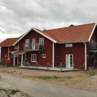 Liten fin lägenhet med balkong centralt o bra läge, hotell i Käringön