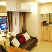 2BR + Work Office + Staycation with 65-inch Smart TV, PS4, High speed Internet and Netflix