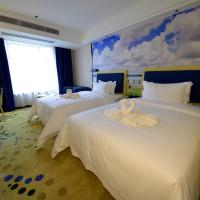 New Coast Holiday Condo Hotel, отель в городе Чжаньцзян