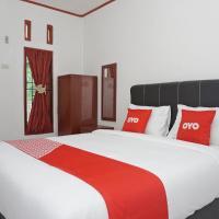 OYO 2635 Ramos Inn, отель в городе Sinapuran