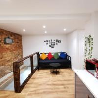 Self contained flat with 5 sleeps & a travel cot, entertainment room, kids play area