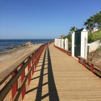 Front line beach bungalow with open sea views located in Mijas Costa Málaga CS105