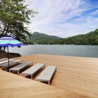 Lake Lure waterfront at Rumbling Bald with docks, views and use home