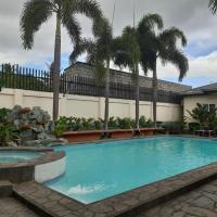 OYO 593 Plumeria Hotel, hotel sa Santo Tomas