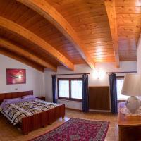 Accogliente mansarda per vacanze nella natura, hotel in Tuenno