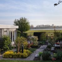 Cottage Geestmerambacht, een nieuw vrijstaande sfeervol en landelijk gelegen vakantiewoning