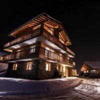 Chalet Haut de cry by Swiss alps village