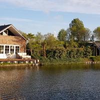 Prachtig vrijstaand appartement aan het water, hotel in Heerhugowaard