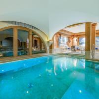 Val d'Isère - Extraordinaire Chalet Montana avec piscine sur la piste Olympique de Belevarde.