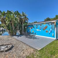 Colorful Canalfront Home with Boat Dock and Yard!
