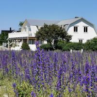 Villa Neptuni lägenhet och rumsuthyrning, hotell i Byxelkrok
