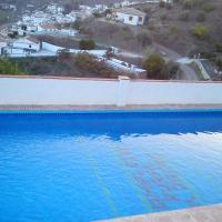 House with 4 bedrooms in El Borge with wonderful mountain view private pool furnished terrace 25 km from the beach, hotel em Borge