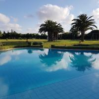 Villa with one bedroom in Bouskoura, with shared pool and enclosed garden - 12 km from the beach, hotel in Bouskoura