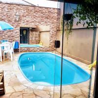 Quarto, piscina e garagem