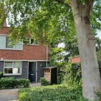 Familyhome near woods, golf and spa, hotel in Oosterhout