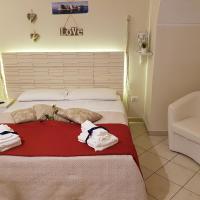 Philos - Appartements & Rooms