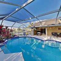 Canal-Front Retreat w/ Boat Dock & Screened Pool home