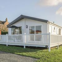 Stylish lodge set in the Sand le Mere Holiday Park