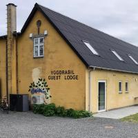 Yggdrasil Guest Lodge, hotel i Gudhjem