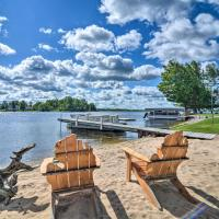 Large Waterfront Cottage with Boat Dock and Beach, hotel in Gladwin