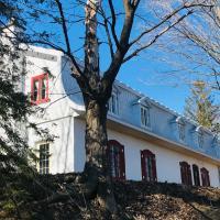 Le Clos des Brumes Chalet, hotel em Chateau Richer