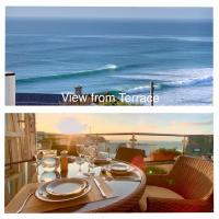 Golden Bay Apartments CLIFFTOP apartment 200m from FISTRAL BEACH SLEEPS 6 DINES 6 has 4 BEDS 2 BATHROOMS LARGE TERRACE with AL FRESCO Dining SEA and BEACH VIEWS from TERRACE and front ROOMS WIFI SKY IPTV NINTENDO NETFLIX all rooms PRIVATE PARKING 2 cars