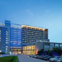Blue Horizon Hotel - University of Petroleum, отель в городе Huangdao