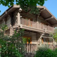 Деревянный дом-шале среди лесов и полей